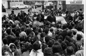 Martin Luther King, Jr. speaking at a rally on a Chicago street corner.